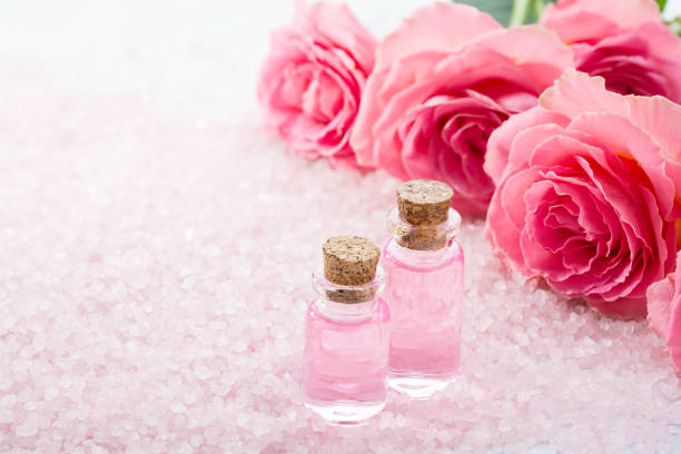 Two bottles with rose oil spa salt crystals and pink roses picture id1160726417?b=1&k=6&m=1160726417&s=612x612&w=0&h=zlnbbvpkygewdyjlxv38wlxifabnayenls6ciscirzk=