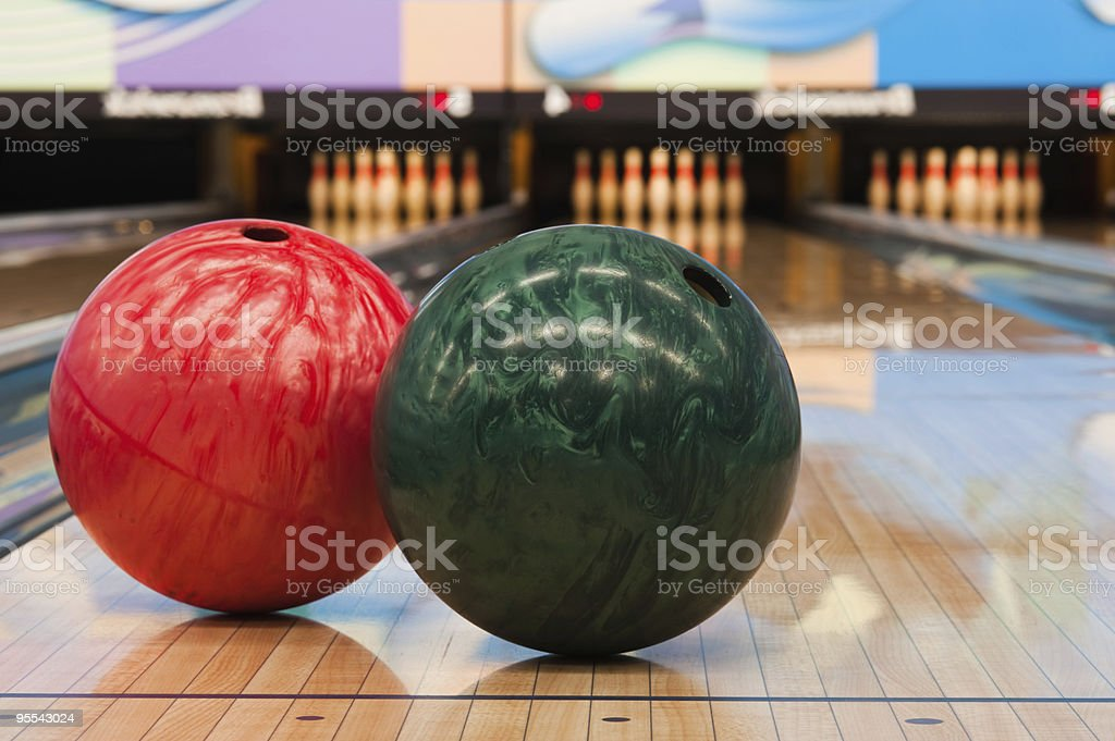 Two bowling balls and pins