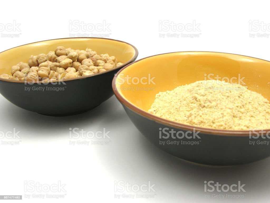 Two bowls of ceramic with garbanzos and flour of garbanzos stock photo