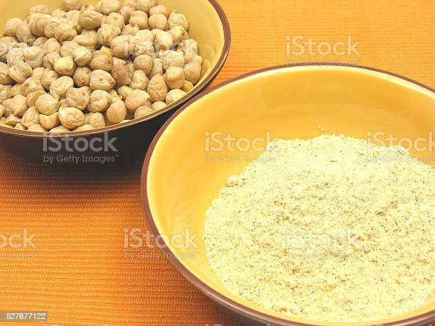 Two bowls of ceramic with garbanzos and flour