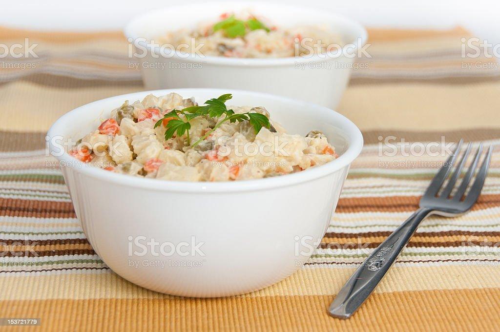 Two bowls of potato salad on yellow napkin stock photo