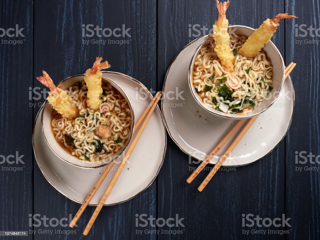 Two bowls of tempura udong noodles stock photo