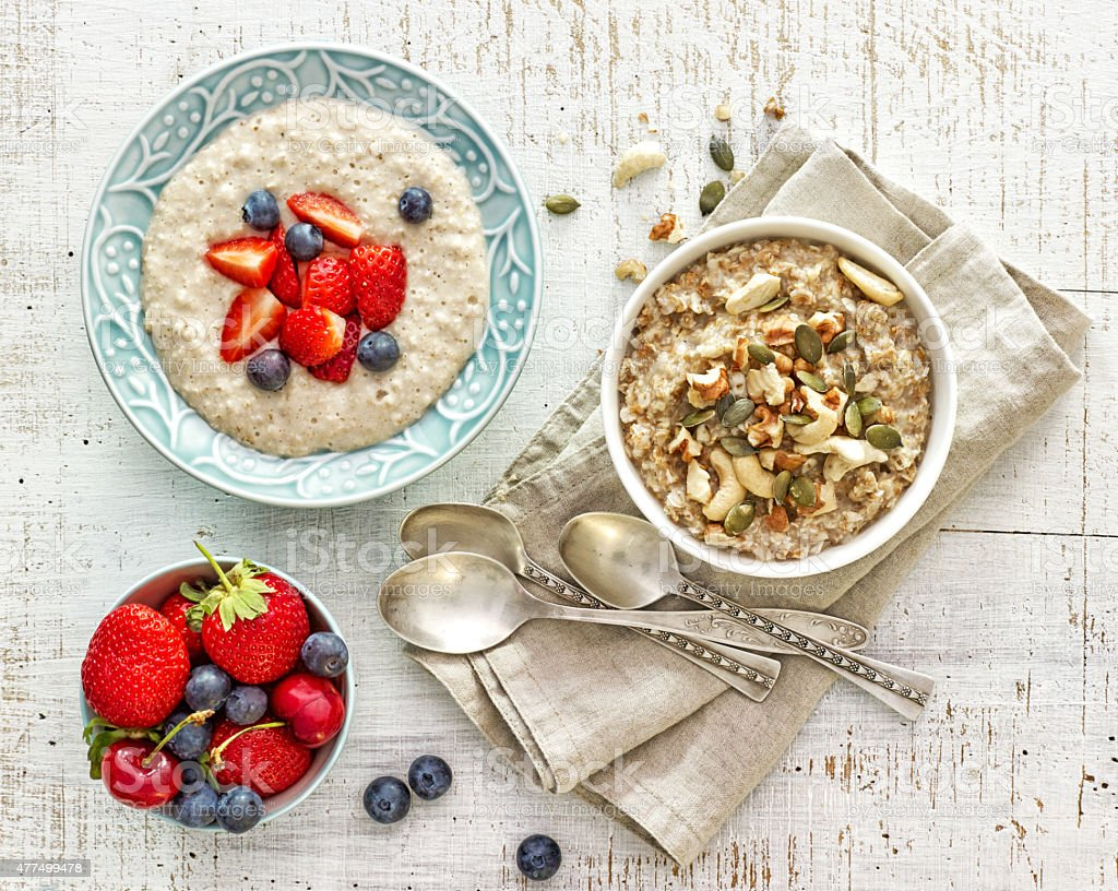 two bowls of various porridge for healthy breakfast stock photo
