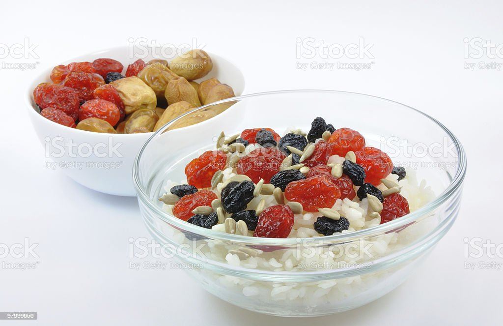 Two Bowls with Rice and Dried Fruit Isolated royalty-free stock photo