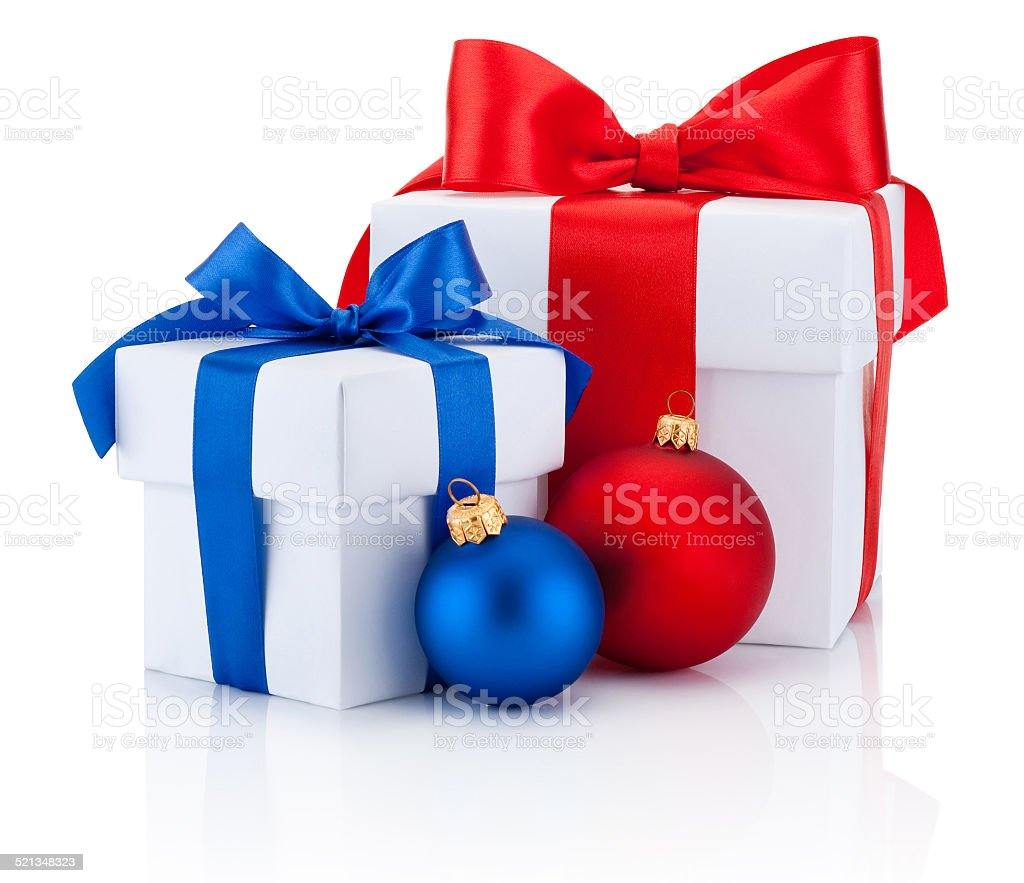 Two boxs tied red and blue ribbon and christmas balls stock photo
