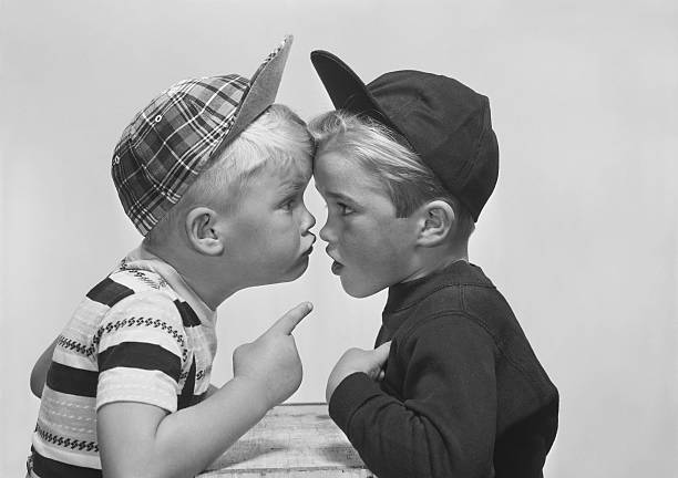 Two boy arguing, close-up stock photo