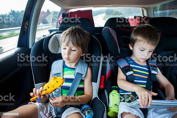 Two boy in car seats traveling in car and playing picture id486669308?b=1&k=6&m=486669308&s=612x612&h=zz8takfso1kzmfp2webzyalzzyke 7qovylj0talg0y=