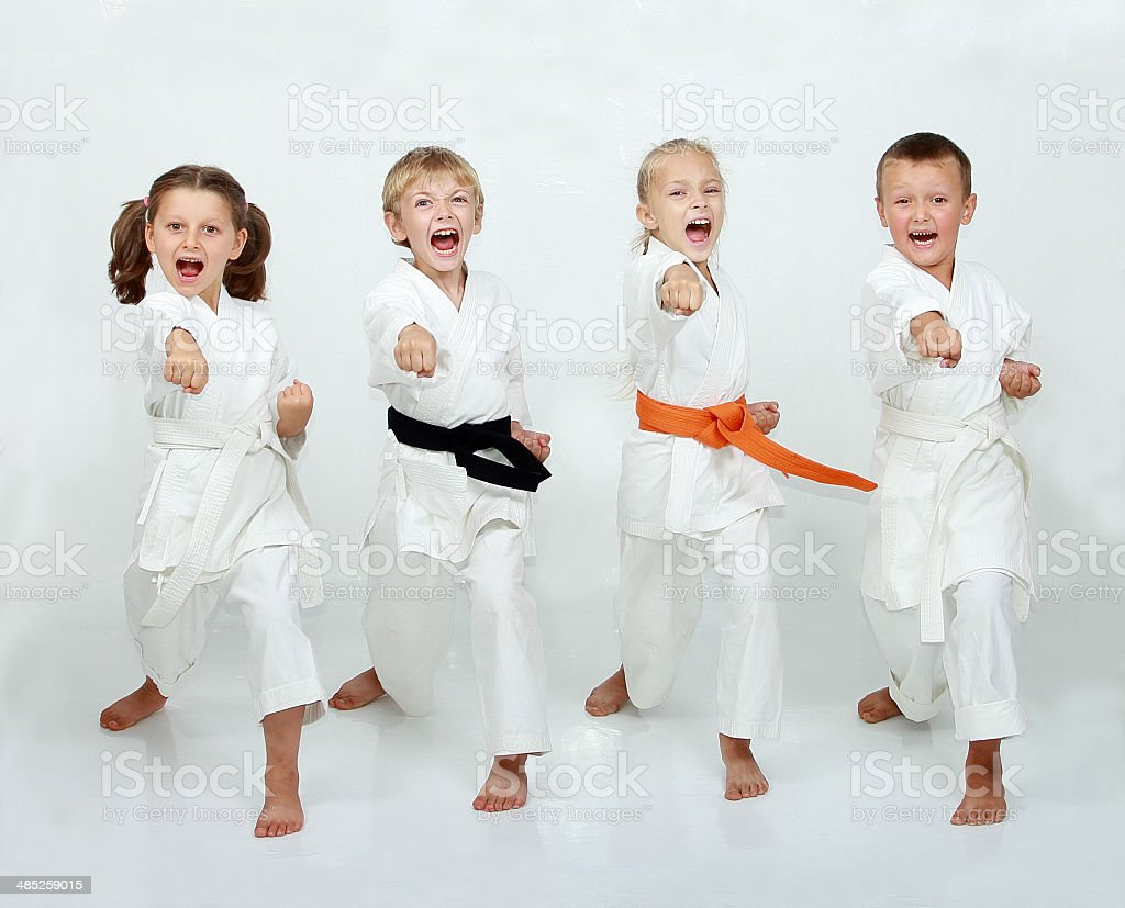 Two boys and two girls are hitting punch arm stock photo