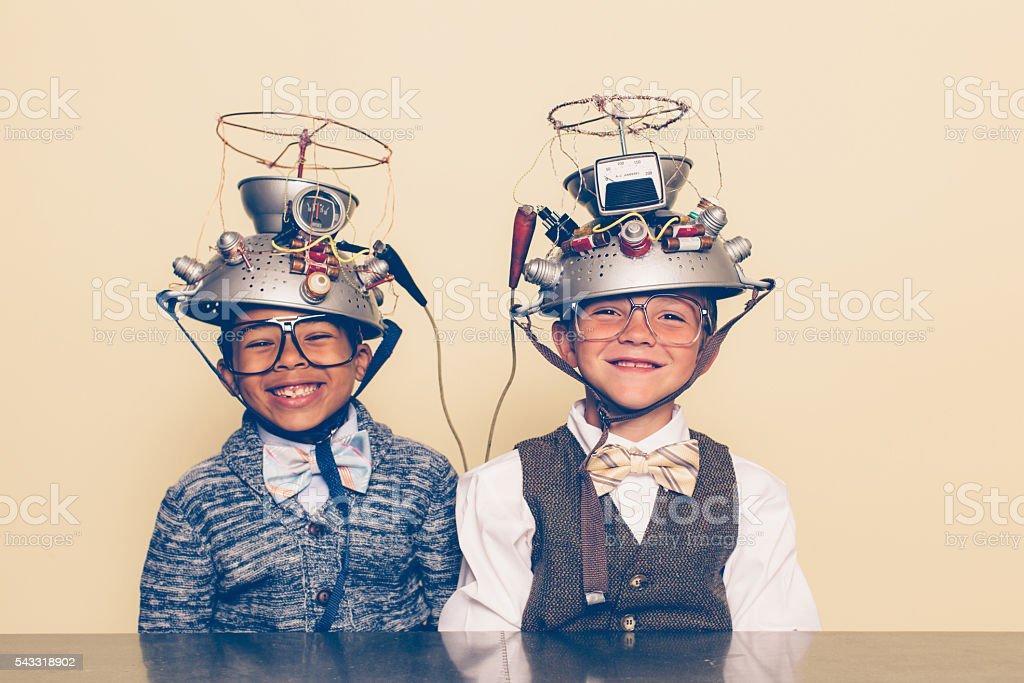 Two Boys Dressed as Nerds Smiling with Mind Reading Helmets royalty-free stock photo