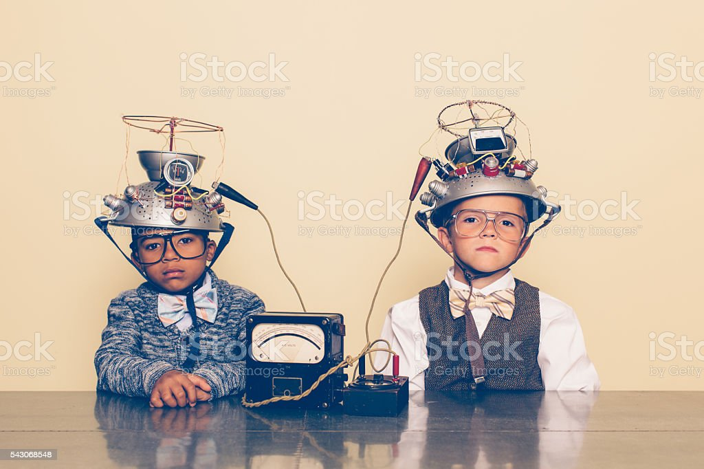 Two Boys Dressed as Nerds with Mind Reading Helmets stock photo
