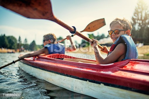 istock Two boys enjoying kayaking on lake 1188850437