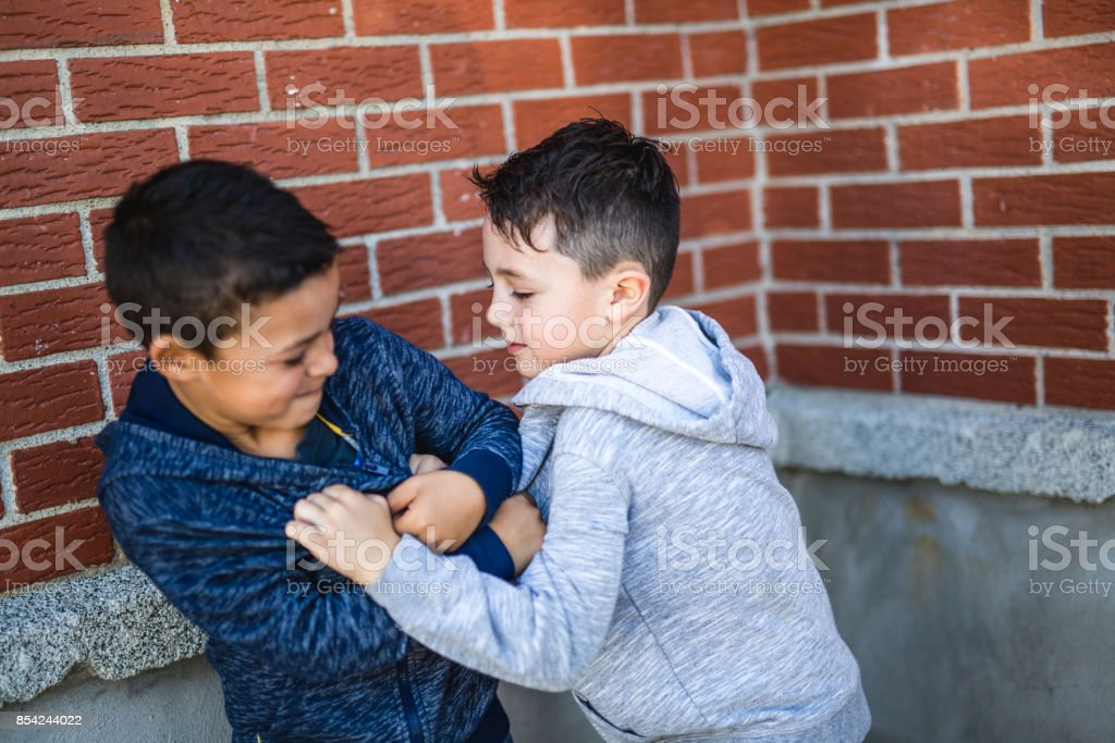 Two Boys Fighting In Playground stock photo