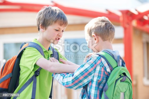 istock Two Boys Fighting In School Playground 490739303