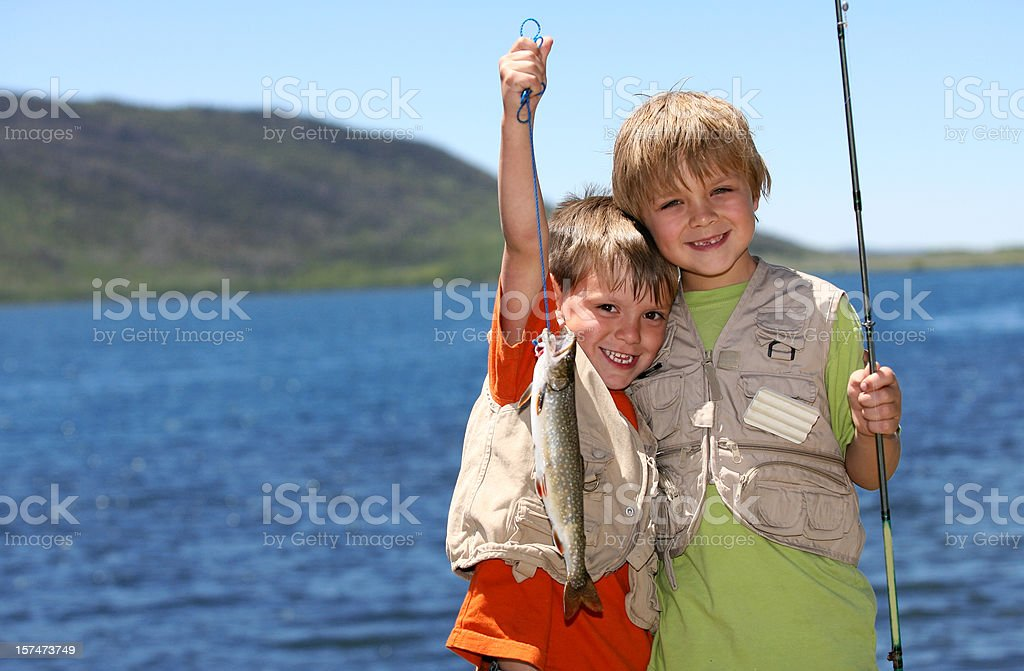 Two boys fishing stock photo