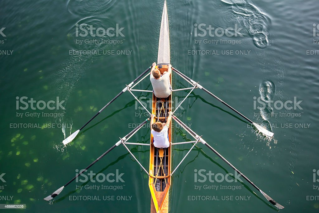 Two boys in a boat stock photo