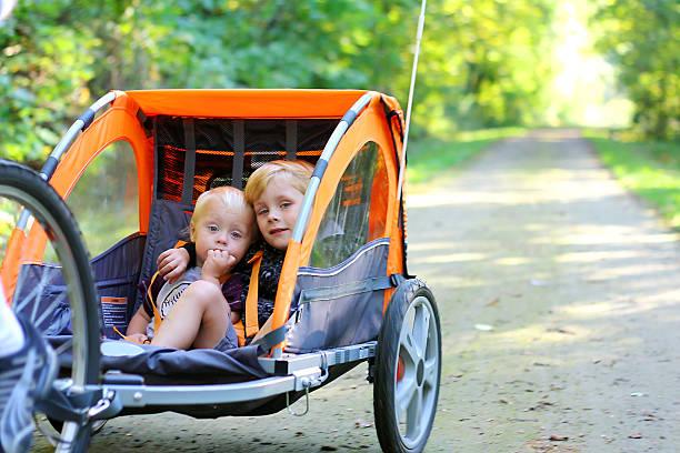 Two Boys in Bike Trailer Outside stock photo