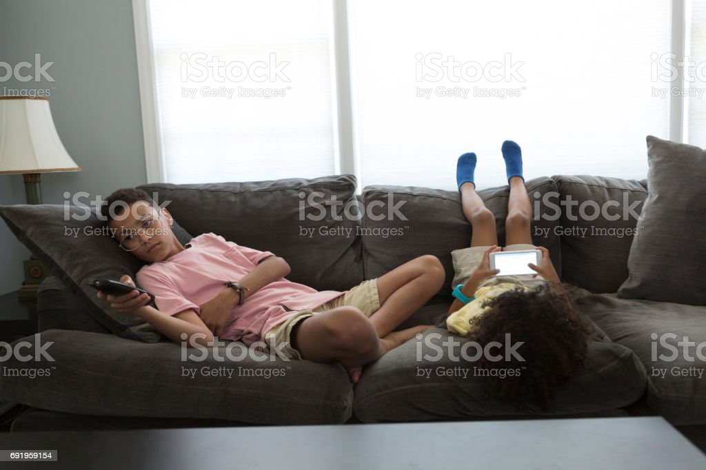 Two Boys on Their Phones stock photo