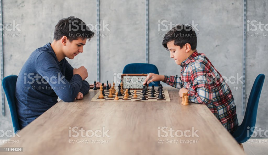 Two Boys Playing Chess In School Of Chess Stock Photo