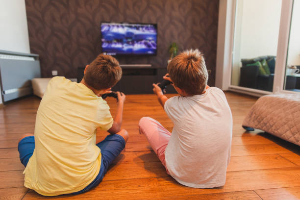 Two Boys Playing Games stock photo