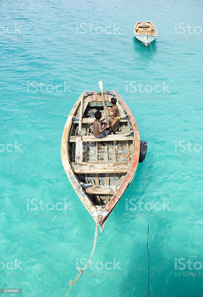 two boys playing in boat. royalty-free stock photo