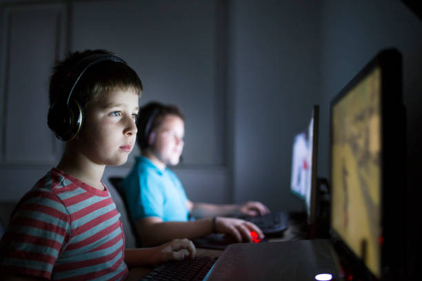 Two boys playing online games stock photo