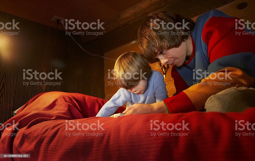 Two boys (4-13) playing video game royalty-free stock photo