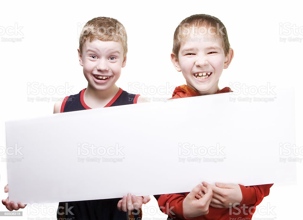 Two boys show a white paper royalty-free stock photo