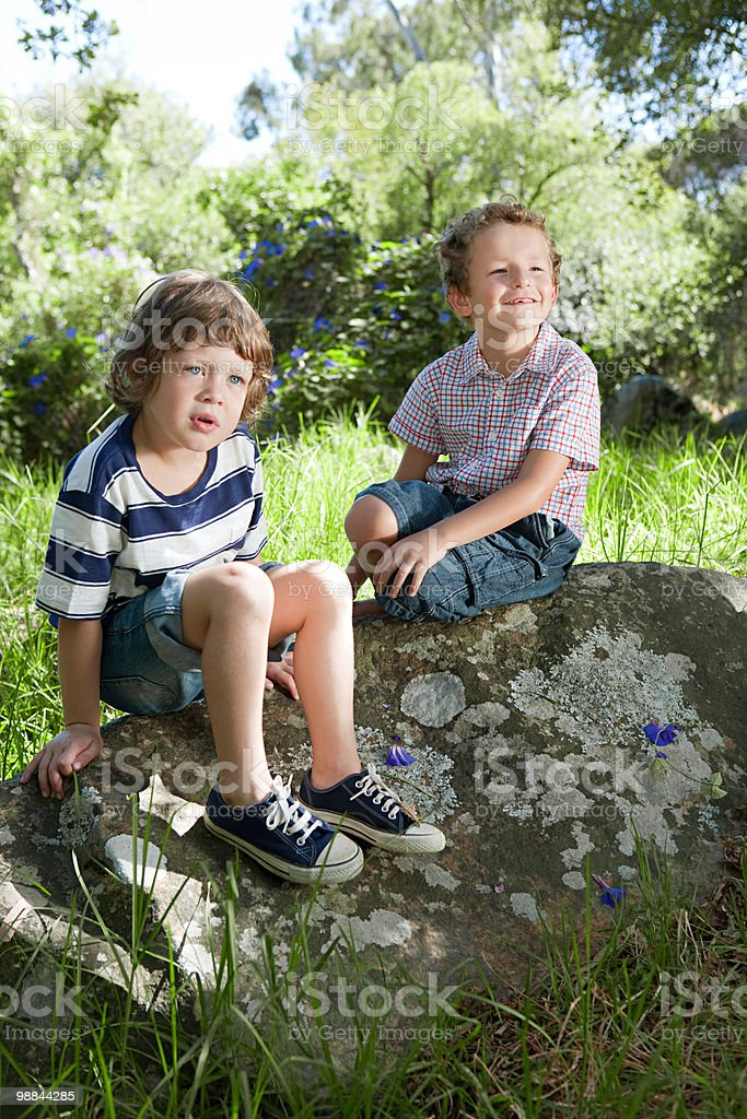 Two boys sitting on a rock 免版稅 stock photo