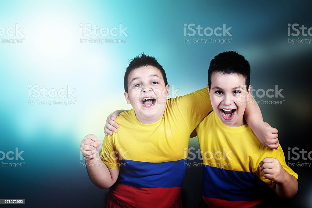 Two boys soccer  fans with flag of Colombia on t-shirt - foto de stock