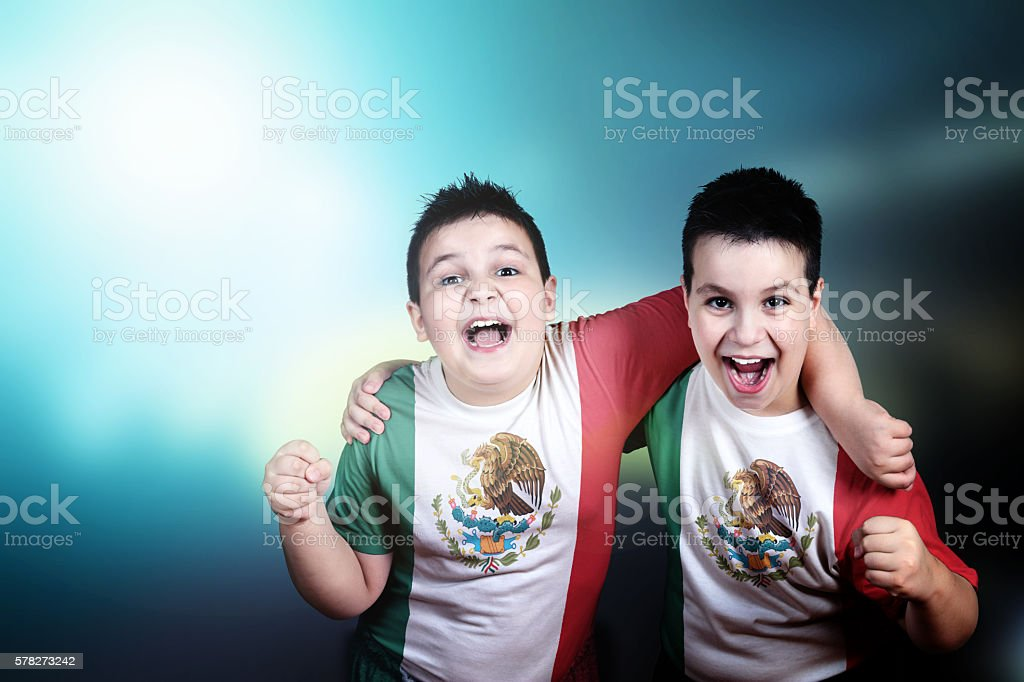 Two boys soccer fans with flag of Mexico on t-shirt - foto de stock