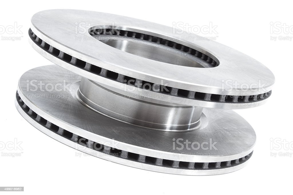 two brake discs and brake pads on a white background stock photo