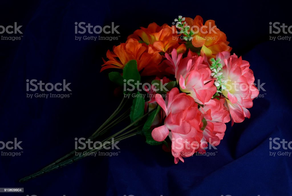 two branches artificial flowers stock photo