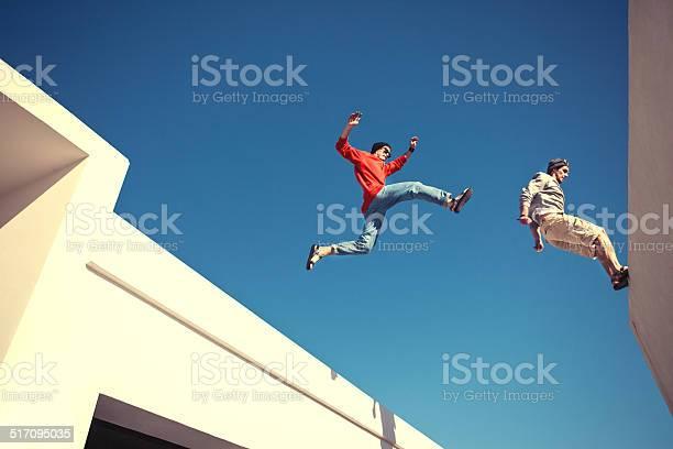 Two brave men jumping over the roof picture id517095035?b=1&k=6&m=517095035&s=612x612&h=8emqwcikgrkqorioof4b9eknycvsgjeqbjtjfm1uw6i=