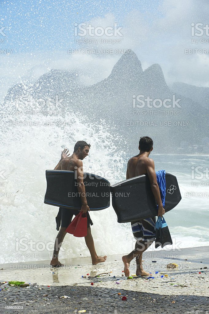Two Brazilian Surfers Carry Bodyboards in Rio de Janeiro royalty-free stock photo