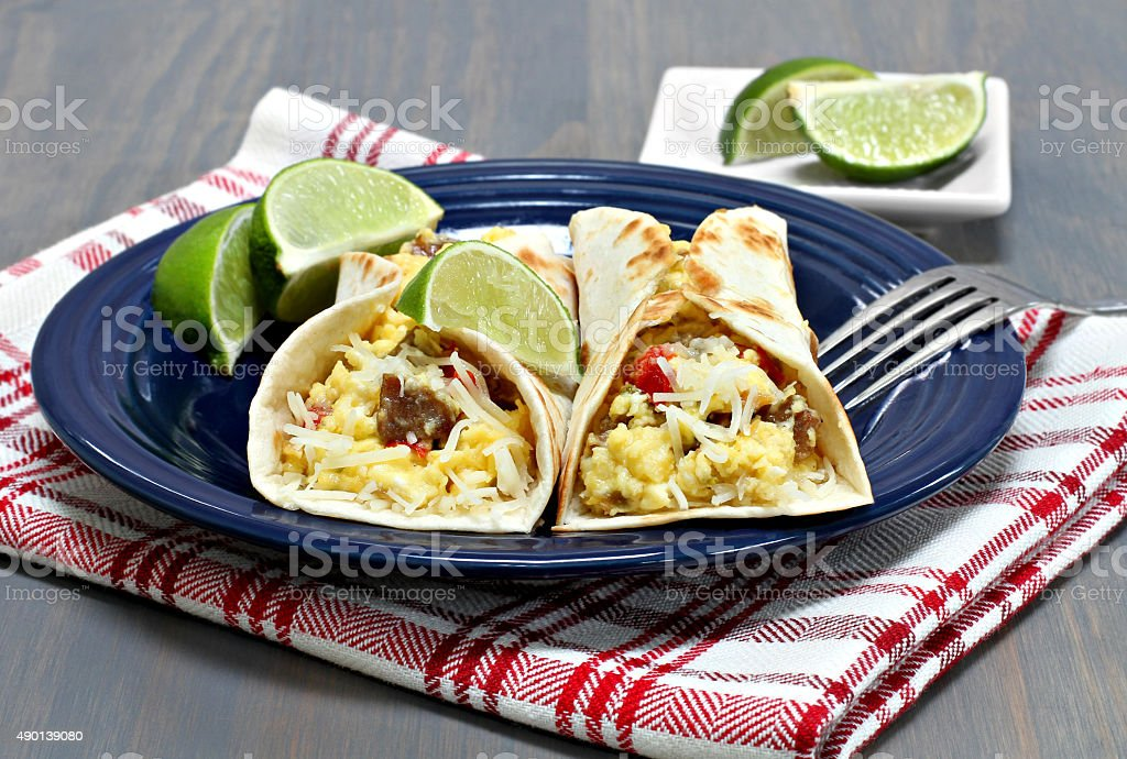 Two breakfast tacos with chorizo, eggs and peppers. stock photo