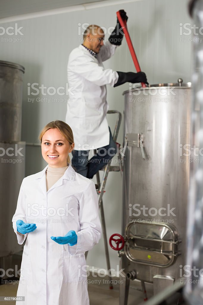 Two brewery workers on beer factory stock photo