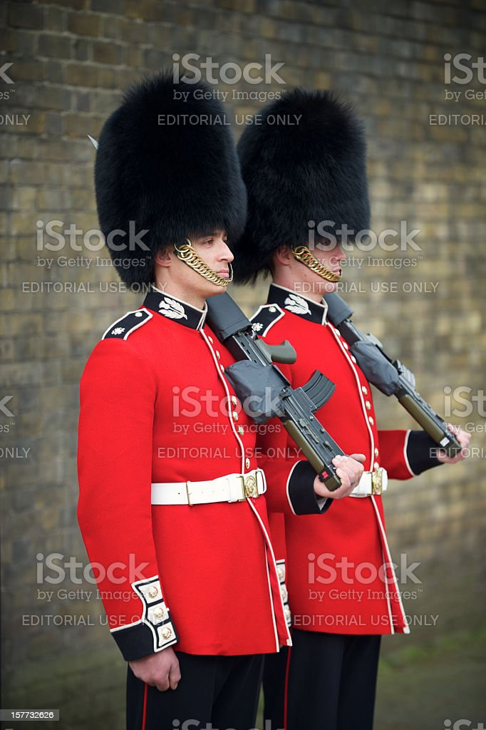 Two British Royal Foot Guards Red Jacket Busby London stock photo