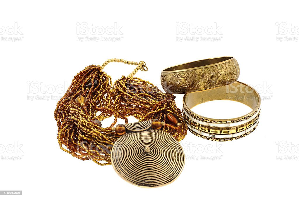 two bronze bracelets and a necklace royalty-free stock photo