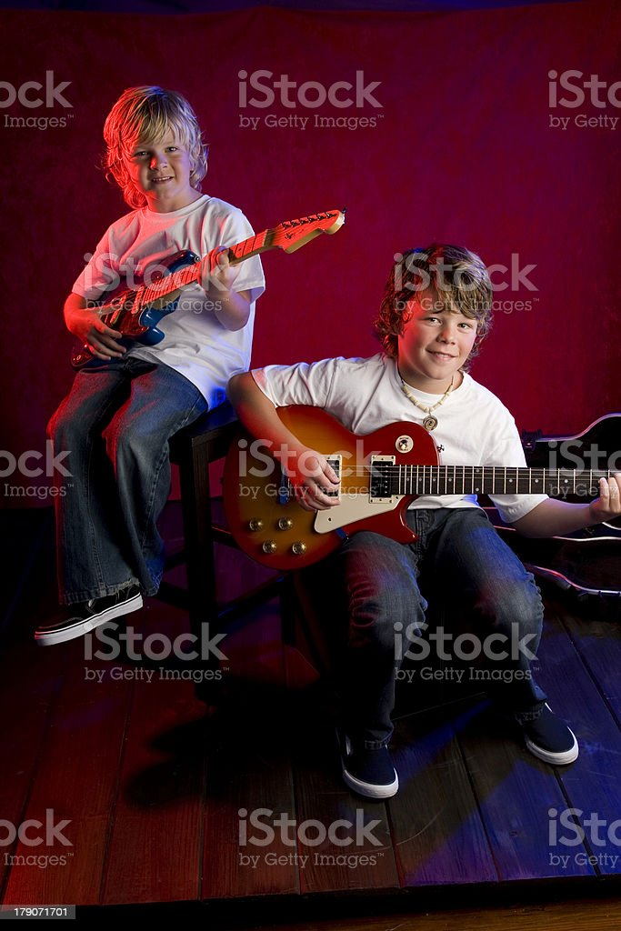 Two Brothers and Their Garage Band royalty-free stock photo