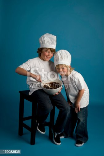 istock Two Brothers Bake Brownies 179083535