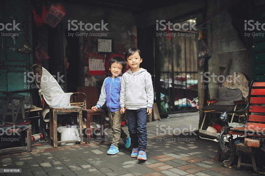 Two brothers in the hutong stock photo