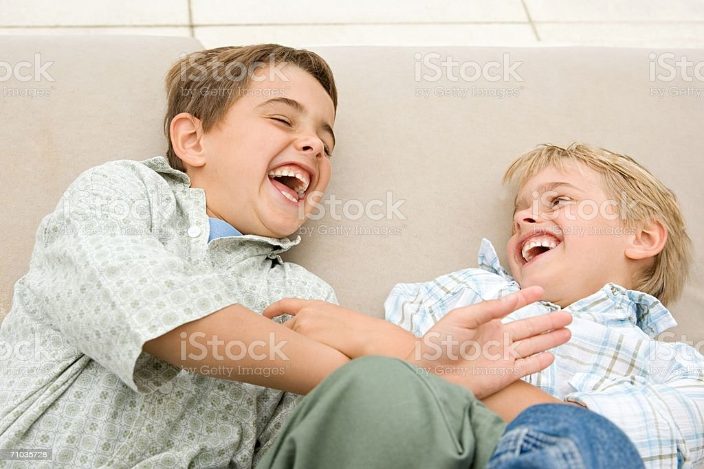 Two brothers tickling each other royalty-free stock photo