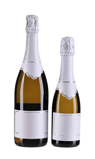 zwei braune flaschen champagner. - mini weinflaschen stock-fotos und bilder
