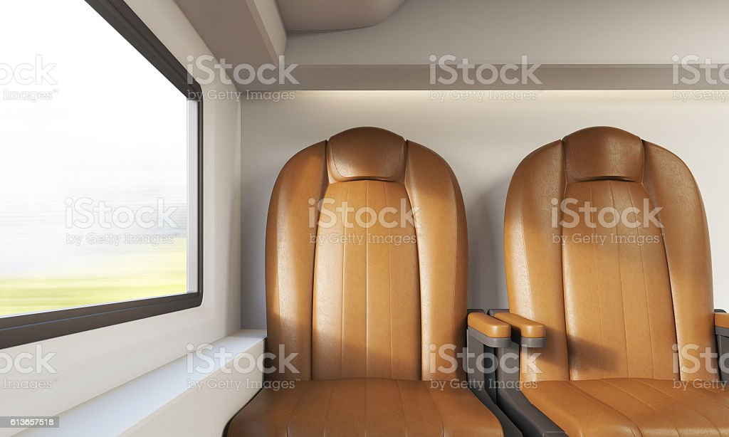 Two brown leather chairs in airplane stock photo