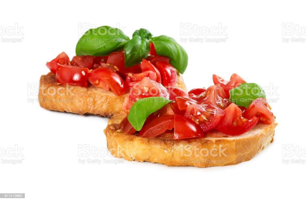 Two bruschetta with fresh tomato and basil stock photo