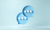 istock Two bubble talk or comment sign symbol on blue background. 1304849823