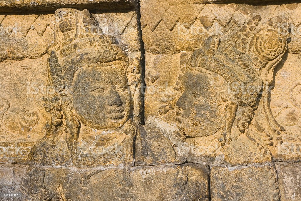 Two buddha figures carved on stone royalty-free stock photo