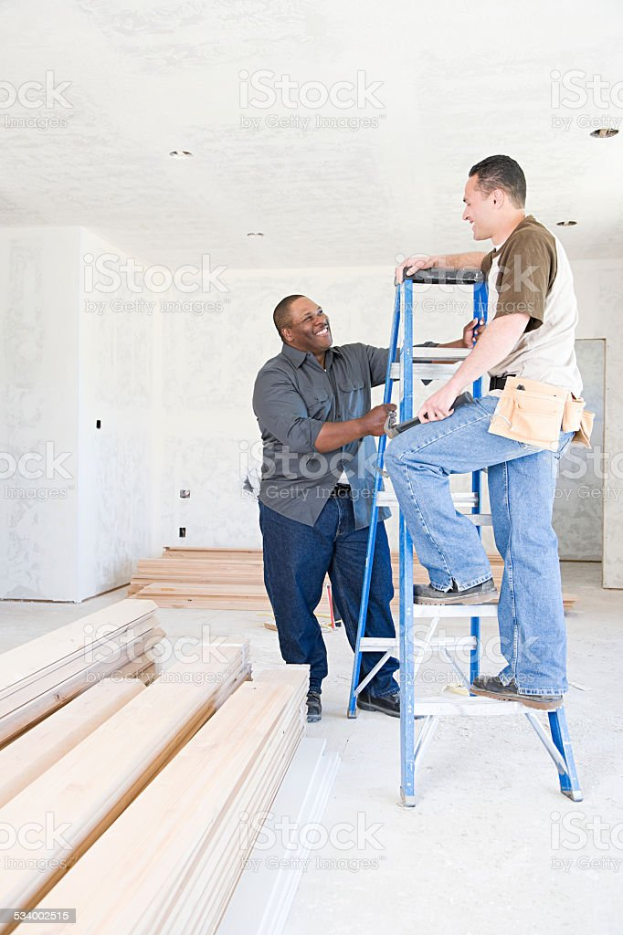 Two builders talking stock photo