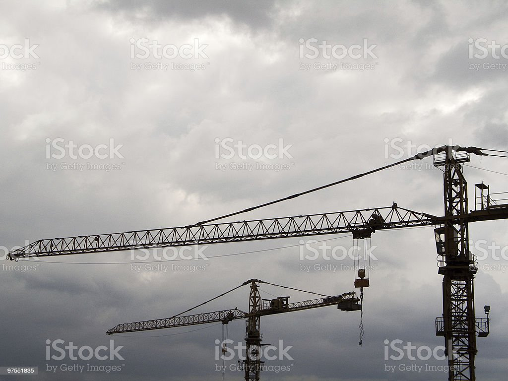 Two building cranes royalty-free stock photo