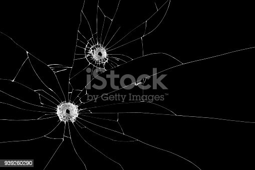 istock Two bullet holes on window isolated on black background. Cut out. 939260290